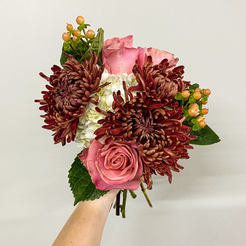 Close-up of red, pink, and white flower bouquet