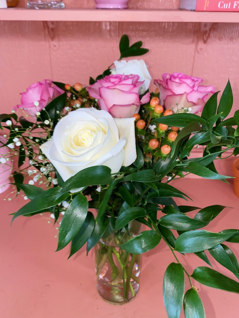 floral arrangement with white and pink roses